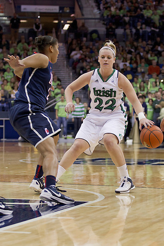 Notre Dame guard Brittany Mallory (#22) dribble the ball as Connecticut forward Kaleena Mosqueda-Lewis (#23) defends in second half action of NCAA Women's basketball game between Connecticut and Notre Dame.  The Notre Dame Fighting Irish defeated the Connecticut Huskies 74-67 in overtime in game at Purcell Pavilion at the Joyce Center in South Bend, Indiana.