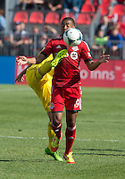18 May 2013: Toronto FC midfielder Reggie Lambe #19 and Columbus Crew midfielder Matias Sanchez #8 in action during the first half in an MLS game between the Columbus Crew and Toronto FC at BMO Field in Toronto, Ontario Canada....