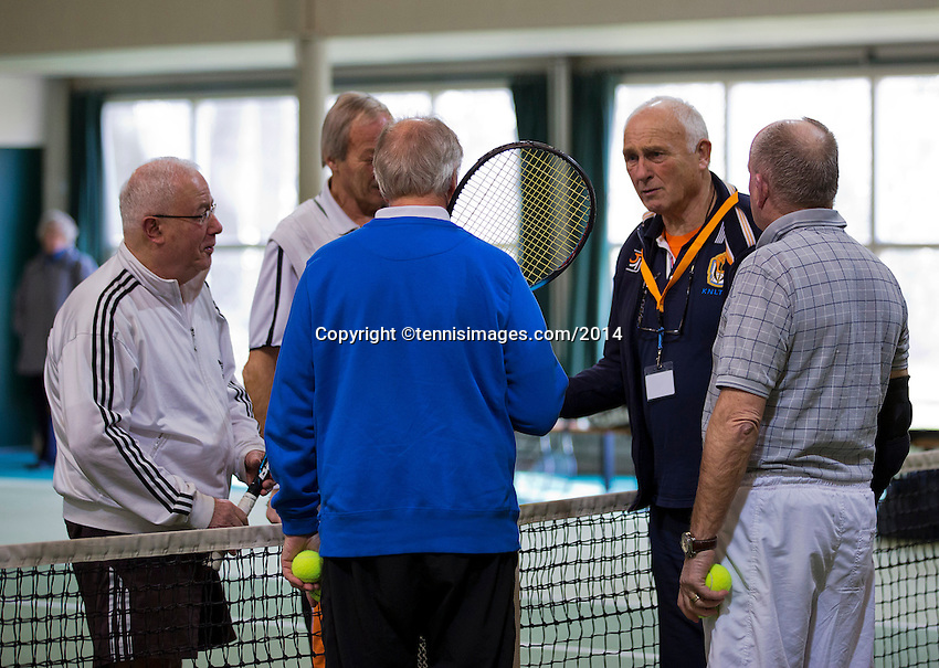 Hilversum, The Netherlands, 05.03.2014. NOVK ,National Indoor Veterans Championships of 2014, umpire does the toss<br /> Photo:Tennisimages/Henk Koster