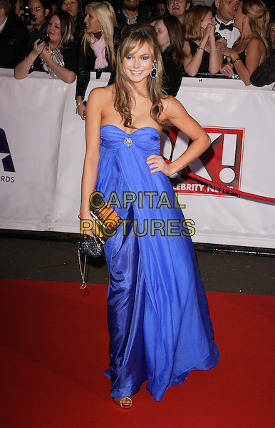 HANNAH TOINTON.The National Television Awards, Royal Albert Hall, London, England..October 31st, 2007.TV full length strapless dress blue purple hand on hip brooch .CAP/ROS.©Steve Ross/Capital Pictures