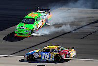 Mar. 1, 2009; Las Vegas, NV, USA; NASCAR Sprint Cup Series driver Brad Keselowski (25) spins as Kyle Busch goes low to avoid during the Shelby 427 at Las Vegas Motor Speedway. Mandatory Credit: Mark J. Rebilas-