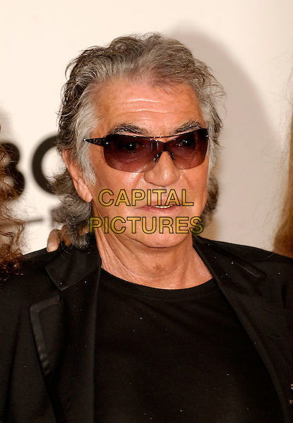 ROBERTO CAVALLI.Arrivals at amfAR's Cinema Against Aids benefit at Moulins de Mougins, Cannes..59th International Cannes Film Festival, France. .25th May 2006.Ref: KRA.headshot portrait sunglasses shades.www.capitalpictures.com.sales@capitalpictures.com.©Capital Pictures