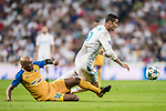 Cristiano Ronaldo (r) of Real Madrid gets tripped by Carlos Roberto Da Cruz Junior, Cariao, of APOEL FC during the UEFA Champions League 2017-18 match between Real Madrid and APOEL FC at Estadio Santiago Bernabeu on 13 September 2017 in Madrid, Spain. Photo by Diego Gonzalez / Power Sport Images