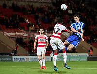 Blackpool's Matty Virtue heads at goal under pressure from Doncaster Rovers' Cameron John<br /> <br /> Photographer Alex Dodd/CameraSport<br /> <br /> The EFL Sky Bet League One - Doncaster Rovers v Blackpool - Tuesday September 17th 2019 - Keepmoat Stadium - Doncaster<br /> <br /> World Copyright © 2019 CameraSport. All rights reserved. 43 Linden Ave. Countesthorpe. Leicester. England. LE8 5PG - Tel: +44 (0) 116 277 4147 - admin@camerasport.com - www.camerasport.com