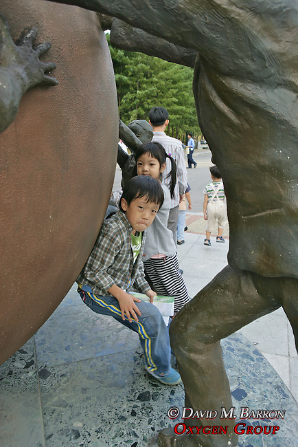 Kids at Unification statue at the DMZ