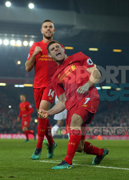 Jordan Henderson of Liverpool looks on as second goal scorer James Milner of Liverpool celebrates  during the Premier League match at the Anfield Stadium, Liverpool. Picture date: November 26th, 2016. Pic Simon Bellis/Sportimage