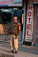 A grim faced soldier stands guardoutside a hotel in central Srinagar, Kashmir, India. © Fredrik Naumann/Felix Features