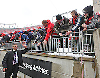 Buckeyes head coach Urban Meyer high fives fans two hours before the start of the game against Indiana at Ohio Stadium on 22, 2014. (Chris Russell/Dispatch Photo)