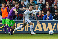 Barrie McKay of Swansea City (R) is pulled back by Marley Watkins of Bristol City during the Sky Bet Championship match between Swansea City and Bristol City at the Liberty Stadium, Swansea, Wales, UK. Saturday 25 August 2018