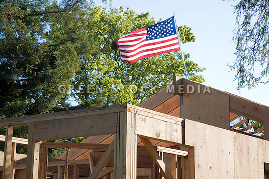 American flag on a major reconstruction project of a single family home. Los Altos, California, USA