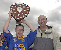 Presentation Miltown Captain Gary Flynn recives the Russell shield from Colleges Officer Peter Twiss after his  team  defeated Kenmare Community School in the Kerry Colleges Russell Shield final at Dr. Crokes field, Killarney  on Tuesday afternoon.<br />