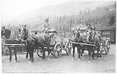 Two teams of horses, each with a heavy wagon, and their teamsters.<br /> RGS  Rico, CO  Taken by Virden, Walter