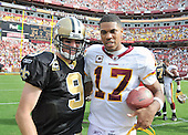Landover, MD - September 14, 2008 -- New Orleans Saints quarterback Drew Brees (9), left, and Washington Redskins quarterback Jason Campbell (17), right, share some thoughts as they leave the field following the Redskins 29 - 24 victory over the Saints at FedEx Field in Landover, Maryland on Sunday, September 14, 2008. The Redskins won the game 29 - 24..Credit: Ron Sachs / CNP.(RESTRICTION: NO New York or New Jersey Newspapers or newspapers within a 75 mile radius of New York City)