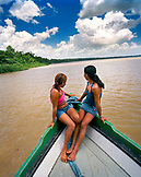 Brazil, Belem, South America, teenage girls sitting on the deck of boat on the Amazon River
