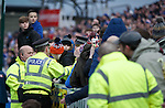 Police and stewards remove banners from the Rangers support