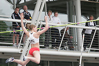20 MAY 2007 - LOUGHBOROUGH, UK - Spectators watch Emma Lyons (ENG) make a successful jump in the pole vault - Loughborough International Athletics. (PHOTO (C) NIGEL FARROW)