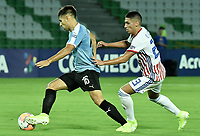 ARMENIA – COLOMBIA, 19-01-2020: Nicolas Acevedo de Uruguay disputa el balón con Erik Lopez de Paraguay durante partido entre Uruguay y Paraguay por la fecha 1, grupo B, del CONMEBOL Preolímpico Colombia 2020 jugado en el estadio Centenario de Armenia, Colombia. / Nicolas Acevedo of Uruguay fights the ball with Erik Lopez of Paraguay during the match between Colombia and Paraguay for the date 1, group B, for the CONMEBOL Pre-Olympic Tournament Colombia 2020 played at Centenario stadium in Armenia, Colombia. Photos: VizzorImage / Gabriel Aponte / Staff