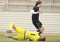 Sonia Bompastor (blue) of the Washington Freedom is stopped by Karen Bardsley  of Sky Blue F.C. during a WPS pre season match at Maryland Soccerplex,in Boyd's, Maryland on March 14 2009. Sky Blue won the match 1-0