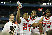 January 5th, 2008:  MVP Ray Rice (27) holds up the MVP award as lineman Jeremy Zuttah (71) and Pedro Sosa (77) look on after the International Bowl at the Rogers Centre in Toronto, Ontario Canada...Rutgers defeated Ball State 52-30.  ..Photo By:  Mike Janes Photography