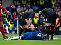 Tammy Abraham of Chelsea injured during the Premier League match between Chelsea and Liverpool at Stamford Bridge, London, England on 22 September 2019. Photo by Liam McAvoy / PRiME Media Images.