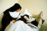 POOR CLARES SISTER COLETTE AND SISTER RAPHAEL IN THE INFIRMARY. No visitors are allowed, they live a silent life of prayer. 1989. 1980s