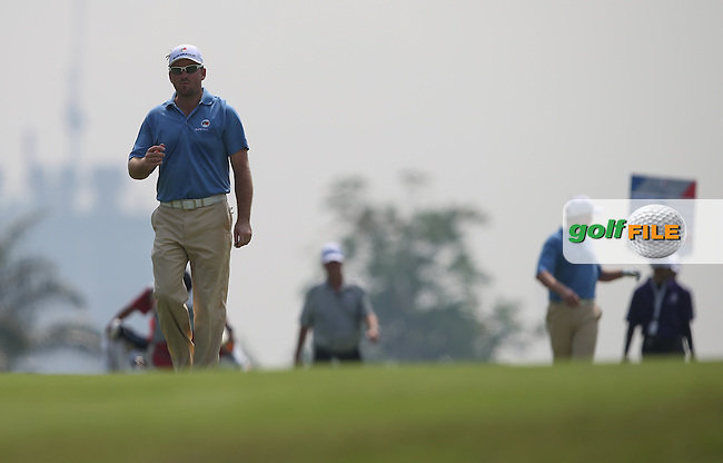 Team Europe's Graeme McDowell (NIR) heads down the 6th during the first day Foursomes at the 2014 Eurasia Cup presented by DRB-Hicom, at the Glenmarie Golf & Country Club, Kuala Lumpur, Malaysia. Picture:  David Lloyd / www.golffile.ie