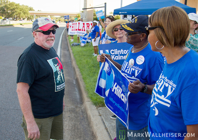 PENSACOLA, FL - SEPTEMBER 09:  Tom Lehane, left, a Republican Presidential candidate Donald Trump supporter, reacts during a disagreement with Democratic Presidential candidate Hillary Clinton supporters prior to a Trump rally at the Pensacola Bay Center on September 9, 2016 in Pensacola, Florida.  The rally drew a full house of 12,000 plus.  (Photo by Mark Wallheiser/Getty Images)