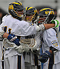 Chris Gray #4 of Shoreham-Wading River, center, gets congratulated by teammates Jon Constant #11, left, and Xavier Arline #24 after he scored a goal against Yorktown in the NYSPHSAA varsity boys lacrosse Class B state semifinals at Hofstra University on Wednesday, June 8, 2016. Gray netted two goals in defeat as Yorktown won by a score of 7-6.