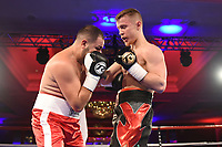 Jack Flatley (black/red shorts) defeats Marian Cazacu during a Charity Dinner Boxing Show at the Hilton Hotel on 13th November 2017