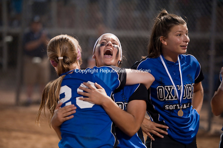 STRATFORD, CT--061215JS06- Oxford's Meghan Sastram (23) and teammate Ashely Lombardi (6) celebrate their 4-0 won over St. Joseph to capture the Class M state championship Friday at DeLuca Field in Stratford. <br /> Jim Shannon Republican-American