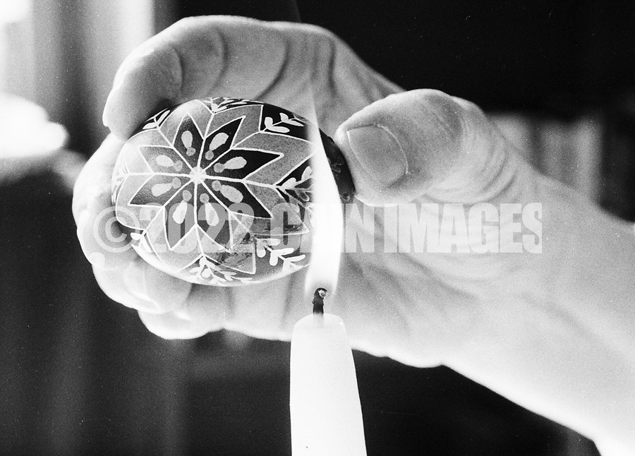 Sister Josaphat Slobodan heats up an egg to melt wax while doing Ukrainian egg decorating, or pysnaky, Tuesday, May 01, 1990 at Sisters of Saint Basil The Great motherhouse in Glenside, Pennsylvania. (Photo by William Thomas Cain/Cain Images)