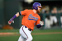 Third baseman Grayson Byrd (4) of the Clemson Tigers runs out a batted ball in a game against the William and Mary Tribe on February 16, 2018, at Doug Kingsmore Stadium in Clemson, South Carolina. Clemson won, 5-4 in 10 innings. (Tom Priddy/Four Seam Images)