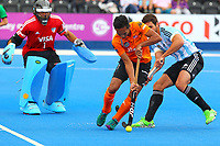 Malaysia's Haziq Samsul holds up play in the Argentine D during the Hockey World League Semi-Final match between Argentina and Malaysia at the Olympic Park, London, England on 24 June 2017. Photo by Steve McCarthy.