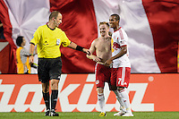 Dax McCarty (11) of the New York Red Bulls celebrates scoring with Roy Miller (7). The New York Red Bulls defeated Real Salt Lake 4-3 during a Major League Soccer (MLS) match at Red Bull Arena in Harrison, NJ, on July 27, 2013.
