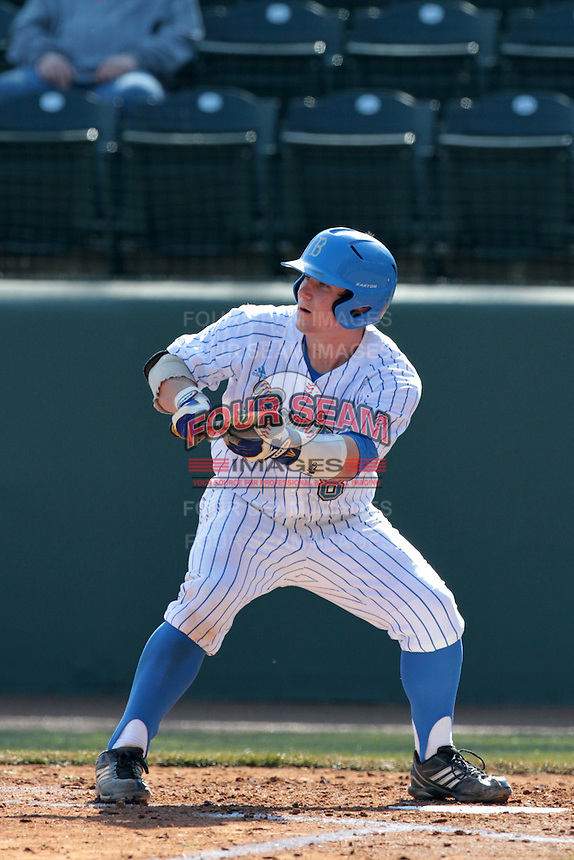 Tyler Heineman #8 of the UCLA Bruins bunts during a game against the Maryland Terrapins at Jackie Robinson Stadium on February 19, 2012 in Los Angeles,California. Maryland defeated UCLA 5-1.(Larry Goren/Four Seam Images)