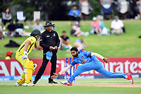India's Shiva Singh fields off his own bowling during the ICC U-19 Cricket World Cup 2018 Finals between India v Australia, Bay Oval, Tauranga, Saturday 03rd February 2018. Copyright Photo: Raghavan Venugopal / © www.Photosport.nz 2018 © SWpix.com (t/a Photography Hub Ltd)