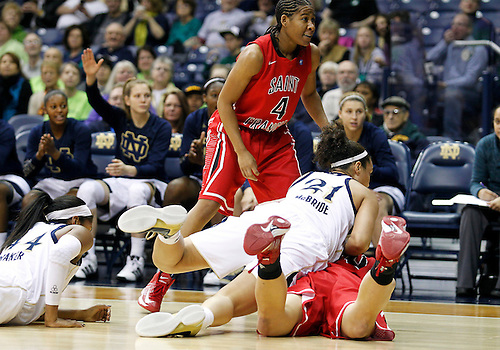 December 31, 2012:  Notre Dame guard Kayla McBride (21) and St. Francis forward Brittany Lilley (20) battle for the loose ball during NCAA Women's Basketball game action between the Notre Dame Fighting Irish and the St. Francis (PA) Red Flash at Purcell Pavilion at the Joyce Center in South Bend, Indiana.  Notre Dame defeated St. Francis 128-55.
