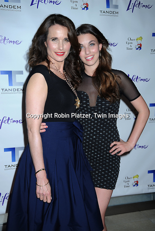 "actress Andie MacDowell in Donna Karan outfit and daughter Rainey Qualley posing for photographers at The Lifetime Television screening of Patricia Cornwell's novel ""The Front"" starring Daniel Sunjata, Andie MacDowell and Ashley Williams at The Hearst Tower on April 7, 2010."