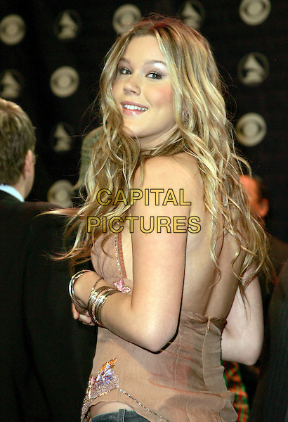 JOSS STONE.The 47th Annual Grammy Award Nominees Announcements. The announcements were held at The Music Box in Hollywood, California .December 7th, 2004.half length, bracelets, looking over shoulder, back.www.capitalpictures.com.sales@capitalpictures.com.Supplied By Capital PIctures