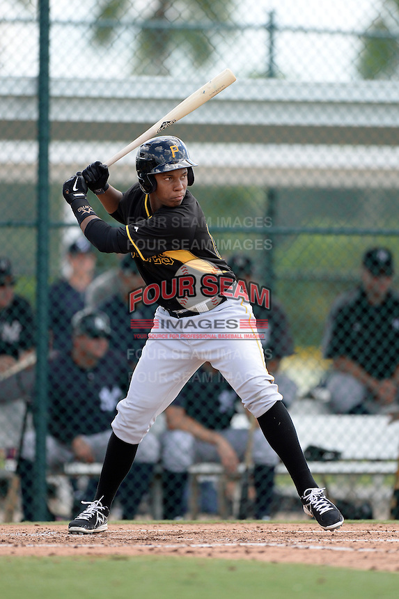 Pittsburgh Pirates third baseman Julio de la Cruz (16) during an Instructional League game against the New York Yankees on September 18, 2014 at the Pirate City in Bradenton, Florida.  (Mike Janes/Four Seam Images)