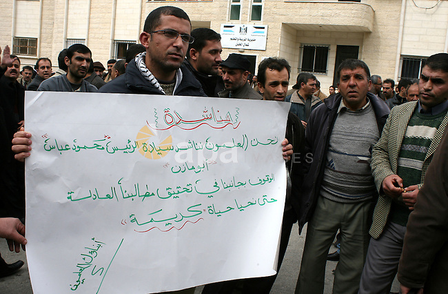 Palestinian teachers take part in a demonstration outside the office of the Directorate of Education in the West Bank town of Halhoul, north of Hebron on Feb. 9,2011. Photo by Najeh Hashlamoun