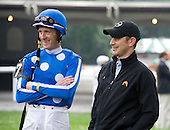 Bernie Dalton and Jonathan Thomas, a former jump jock-turned Todd Pletcher assistant, share a laugh in the paddock at Belmont before the William Entenmann.