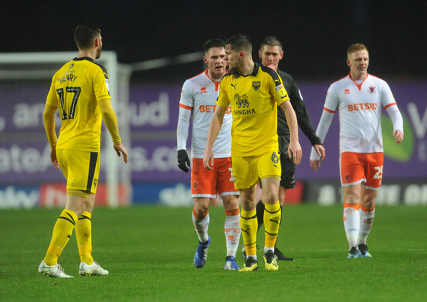 Blackpool's Jordan Thompson remonstrates with Oxford United's Jamie Hanson<br /> <br /> Photographer Kevin Barnes/CameraSport<br /> <br /> The EFL Sky Bet League One - Oxford United v Blackpool - Saturday 15th December 2018 - Kassam Stadium - Oxford<br /> <br /> World Copyright © 2018 CameraSport. All rights reserved. 43 Linden Ave. Countesthorpe. Leicester. England. LE8 5PG - Tel: +44 (0) 116 277 4147 - admin@camerasport.com - www.camerasport.com