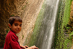 Israel, Upper Galilee. Noam at the Tanur waterfall in Nahal Ayoun Nature reserve