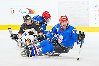 19th November 2019, Berlin, Germany. World Para Ice Hockey Championships, Germany versus Great Britain;    BENTZEN Finn Weserstars is sndwiched between two Great Britain players