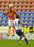 Blackpool's Peter Hartley out jumps Wigan Athletic's Will Grigg<br /> <br /> Photographer Dave Howarth/CameraSport<br /> <br /> The Carabao Cup - Wigan Athletic v Blackpool - Tuesday 8th August 2017 - DW Stadium - Wigan<br />  <br /> World Copyright &copy; 2017 CameraSport. All rights reserved. 43 Linden Ave. Countesthorpe. Leicester. England. LE8 5PG - Tel: +44 (0) 116 277 4147 - admin@camerasport.com - www.camerasport.com