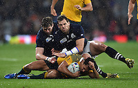 Nick Phipps of Australia is double-tackled to ground by Richie Vernon and Sean Lamont of Scotland. Rugby World Cup Quarter Final between Australia and Scotland on October 18, 2015 at Twickenham Stadium in London, England. Photo by: Patrick Khachfe / Onside Images