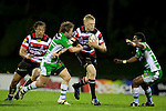 Baden Kerr tries to push off Karl Byson as he heads upfield. ITM Cup rugby game between Counties Manukau and Manawatu played at Bayer Growers Stadium on Saturday August 21st 2010..Counties Manukau won 35 - 14 after leading 14 - 7 at halftime.