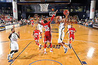 28 January 2012:  FIU guard Cameron Bell (10) puts up a basket around WKU guard T.J. Price (52) in the second half as the Western Kentucky University Hilltoppers defeated the FIU Golden Panthers, 61-51, at the U.S. Century Bank Arena in Miami, Florida.