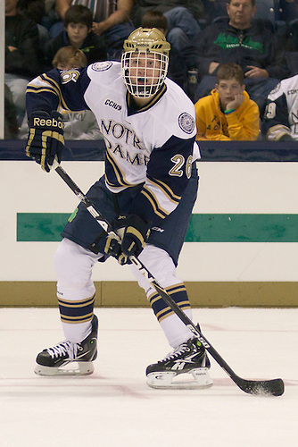 Notre Dame left wing Nick Larson (#26) in third period action of NCAA hockey game between Notre Dame and Rensselaer Polytechnic Institute (RPI).  The Notre Dame Fighting Irish defeated Rensselaer Polytechnic Institute (RPI) Engineers 5-2 in game at the Compton Family Ice Arena in South Bend, Indiana.